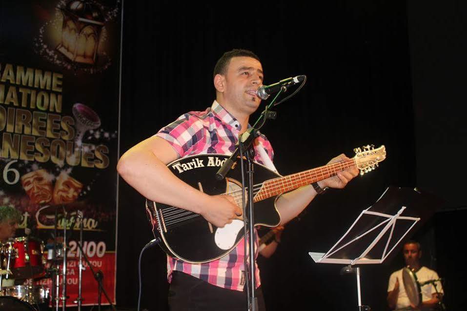 Tariq Ʃebdat, acennay ilemẓi n Tezlit Taqbaylit seg At Wizgan